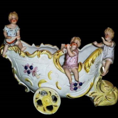 Cherubijnen porseleinen koekje eind 19e eeuw